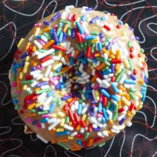 Aww Shucks - Honey glaze and rainbow sprinkles donut.