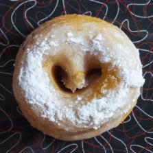 Cow Tail - Caramel glaze and powdered sugar donut.