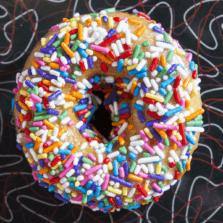 Pony Party - Strawberry glaze and rainbow sprinkles donut.