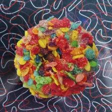 Yabba Dabba Doo-Nut - Honey glaze with fruity pebbles donut.